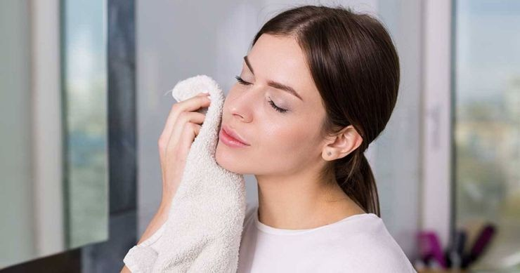 Woman-patting-her-face-dry-with-towel